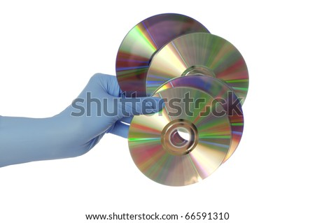 inspector in blue gloves holds in a hand confidential audio and video about hacker programs and viruses - stock photo