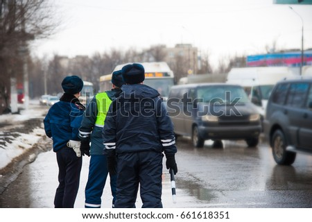 Inspector of traffic police regulates the movement of transport. Traffic policemen, Police, DPS