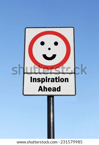 Inspiration Ahead written on a road sign with a smiling face against a clear blue sky background - stock photo