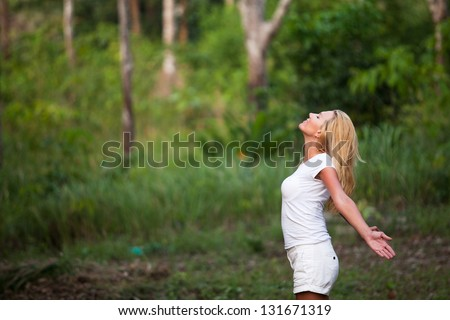 inspiration, enjoying the summer, young woman outdoors - stock photo