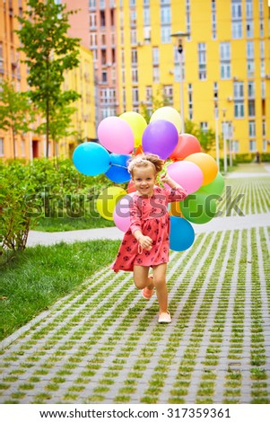 inspiration, happy little girl outdoors with balloons - stock photo