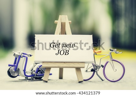 "Inspiration quote  ""Get New Job"" with blur bokeh, easel,wired handcrafted scooter and bicycle background ,Motivational typographic. - stock photo"
