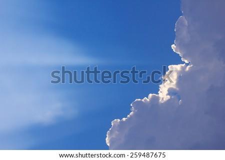 Inspirational cloudscape backlit by sun - stock photo