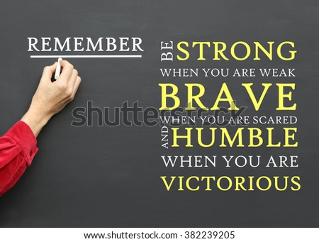 Inspirational  Message To Remember To Be Strong When You Are Weak, Brave When You Are Scared and Humble When You Are Victorious written on a School Blackboard by the teacher - stock photo