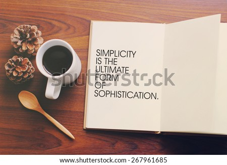 Inspirational motivating quote on notebook and coffee with retro filter effect - stock photo