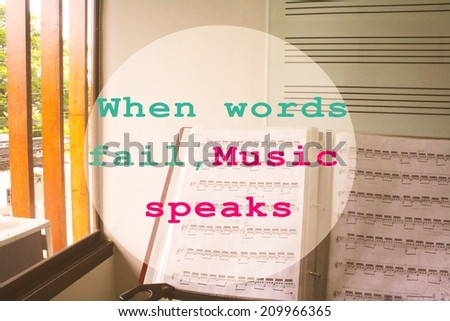 Inspirational motivating quote with sheet music  and music staff backboard as background:When words fail,Music speaks  - stock photo