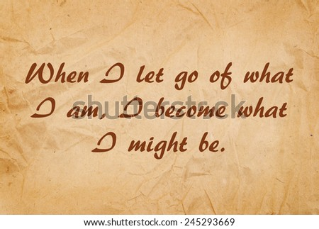 Inspirational motivational life quote by Lao Tzu on old paper background - stock photo