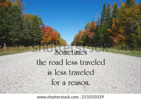 Inspirational quote about life by author Robert Frost with a country road in the autumn. - stock photo