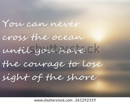 Inspirational quote about the ocean over blurred background of hazy sun over a still ocean at the beach with instagram style colors. Sun is reflected in the ocean and on the wet sand. - stock photo