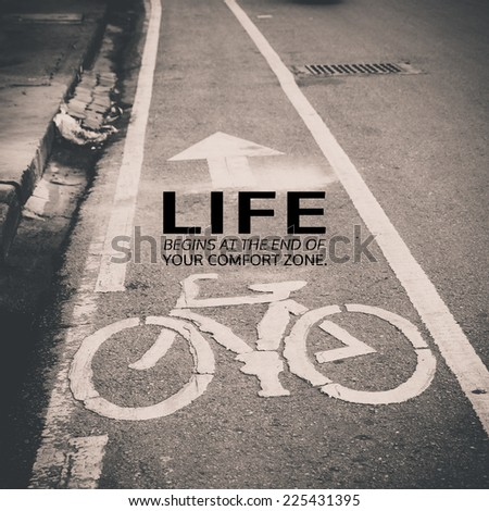 Inspirational quote by unknown source on vintage black and white steet with bicycle lane sign background - stock photo