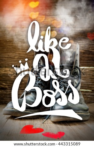 Inspirational Quote .Like a Boss.Wallpaper Poster Typography Design.Pair of old worn leather boots on wooden floor boards - stock photo