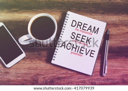 """inspirational quotes """"dream the impossible, seek the unknown, achieve the greatness"""" retro style background  - stock photo"""
