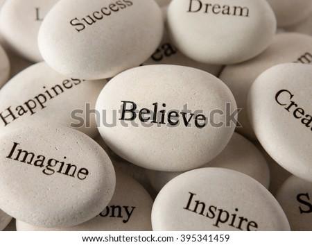 Inspirational stones - Believe - stock photo