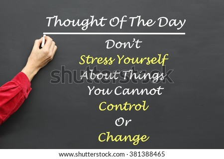 Inspirational Thought For The Day message of Don't Stress Yourself About Things You Cannot Control Or Change written on a School Blackboard by the teacher. - stock photo