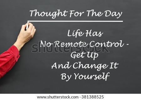 Inspirational Thought For The Day message of Life Has No Remote Control, Get Up And Change It By Yourself written on a School Blackboard by the teacher. - stock photo