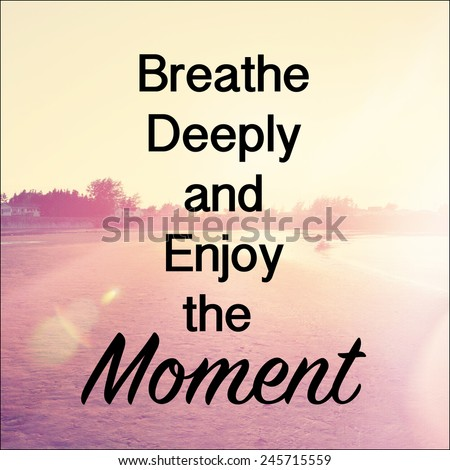 Inspirational Typographic Quote - Breathe deeply and enjoy the moment - stock photo