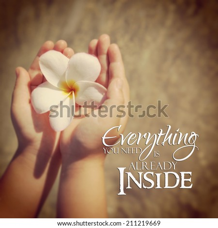 Inspirational typographic quote on beach - everything you need is already inside - stock photo