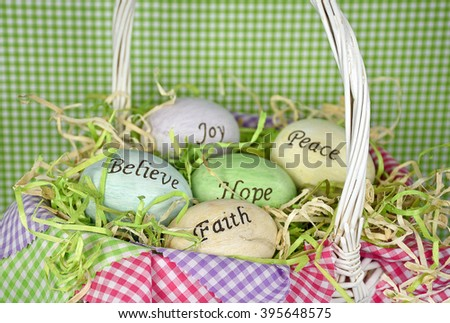 inspirational words on Easter eggs in white wicker basket with grass and gingham - stock photo
