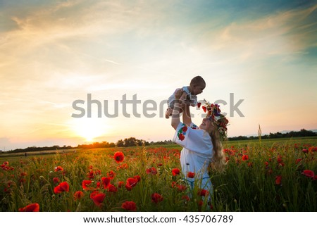 Inspired young mother - stock photo
