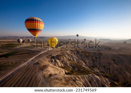 inspiring beautiful landscape with hot air balloons - stock photo