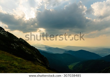 Inspiring Mountains Landscape, summer sunset in Tatras, sunlight over mountain ridge and cloudy sky, Poland - stock photo