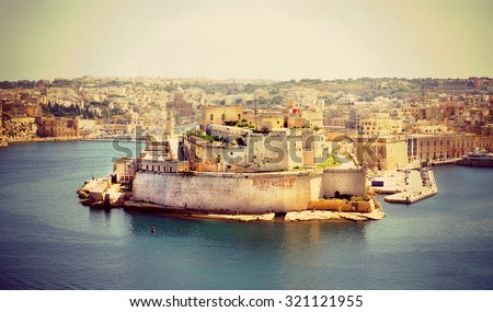 Instagram filter look from the mighty Fort St Angelo that dominates the Grand Harbour of Valetta, Malta  - stock photo
