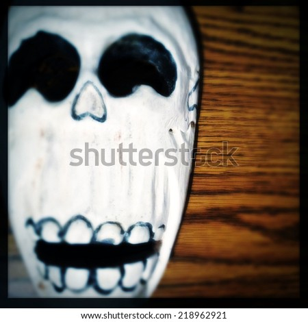 Instagram filtered image of a Day of the Dead skull - stock photo