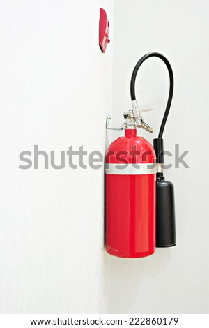 install a fire extinguisher  longtime ago on the wall in buiding - stock photo
