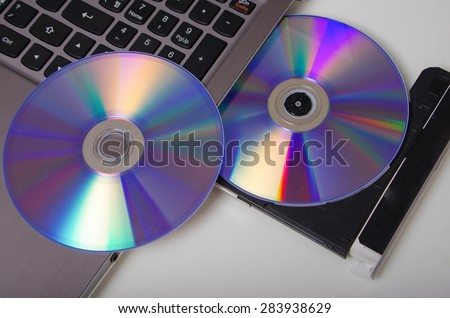 install program, dvd insert to laptop computer - stock photo