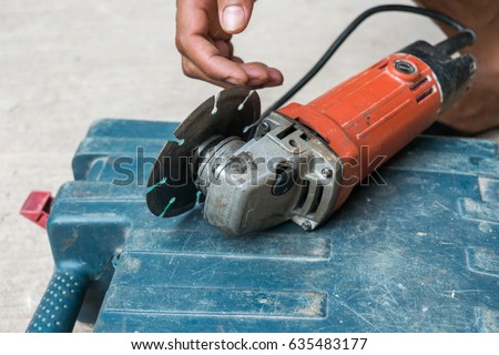 Install saw blade on grinding machine stock photo royalty free install saw blade on grinding machine greentooth Gallery