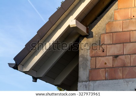 Install soffits in building house. - stock photo