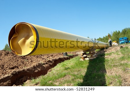 Installation of a gas pipeline against blue sky - stock photo