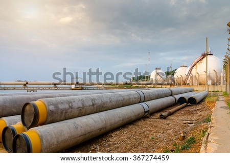 Installation of a gas pipeline from the sea to Natural gas tanks - stock photo