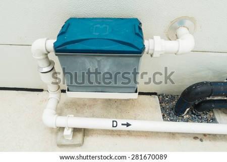 Installation of a grease trap - stock photo