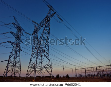 installation of electric towers and cables at sunset