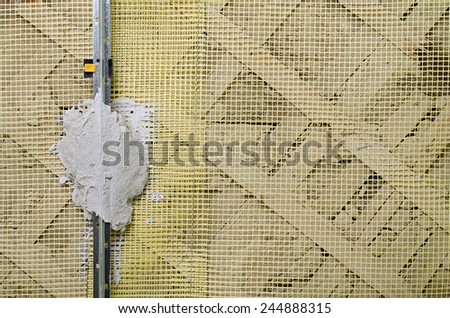 Installation of metal lighthouses, preparation for plaster - stock photo