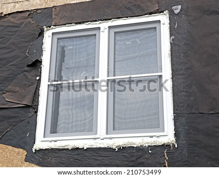 Installation of plastic windows with mosquito nets in the frame house - stock photo