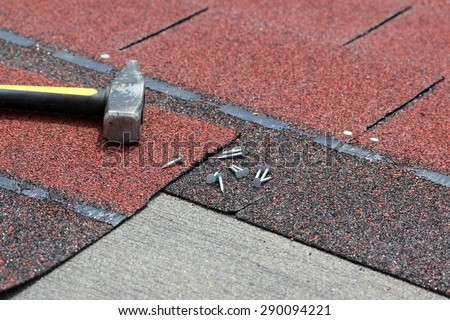 Installation of roof asphalt shingles - stock photo