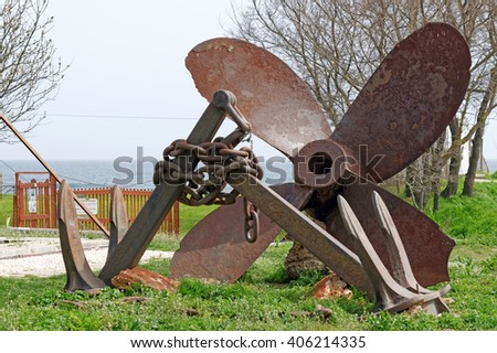 Installation of two ships' anchors and a propeller
