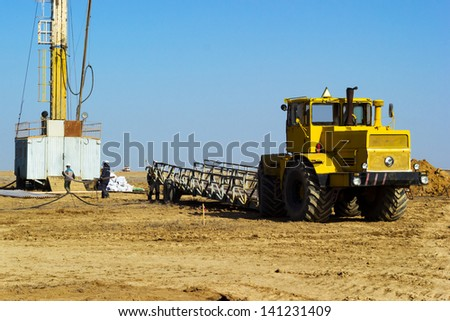 installation to boring rig on industrial site - stock photo