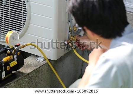Installing air conditioner - stock photo