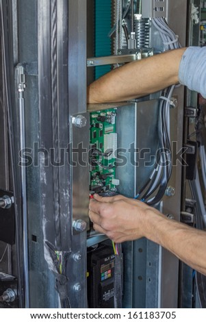 Installing elevator control panel, elevator parts installation - stock photo