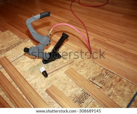 Installing hard-wood flooring - stock photo
