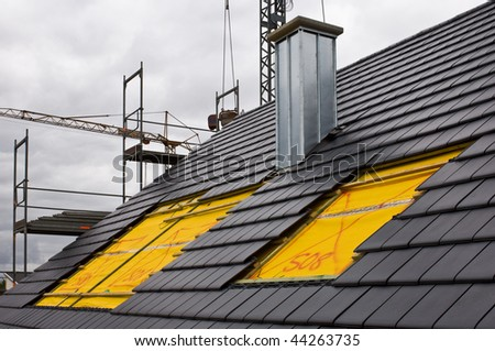 Installing of roof lights on a construction site - stock photo