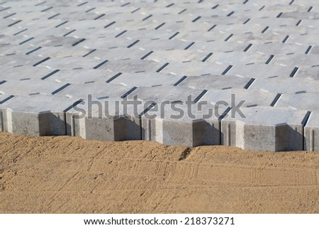 Installing paver bricks on patio during construction works - stock photo