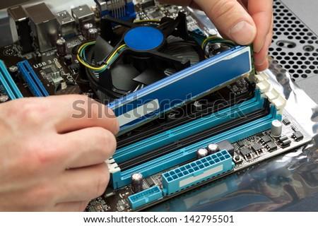 Installing random access memory into PC - stock photo