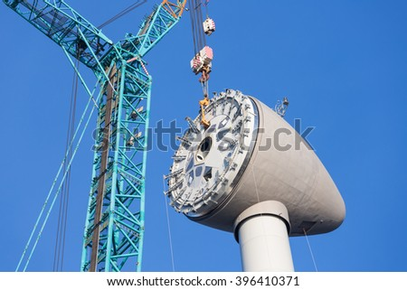 Installing rotor house at the top of a big new Dutch wind turbine - stock photo