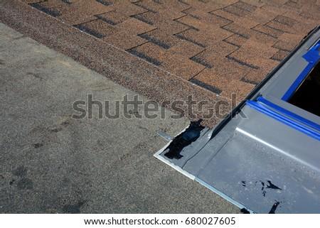 Installing Skylights Window In New Home Closeup. Bitumen Roof Shingles. Vapor  Barrier And Waterproofing