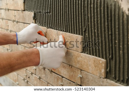 Installing Tiles On Wall Worker Putting Stock Photo 523140304 ...