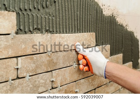 Installing Tiles On Wall Worker Putting Stock Photo 592039007 ...